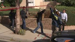 Investigators outside bar shooting suspect's home