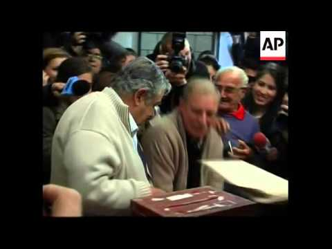 Voters chose between ex-rebel and ex-president in Uruguay elections