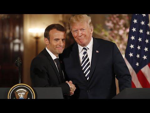Trump and Macron share an awkward handshake and a kiss