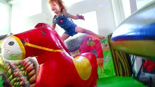 Adley Rides her inflatable Spirit Horse!! Giant play slide and kid toys with Dad!