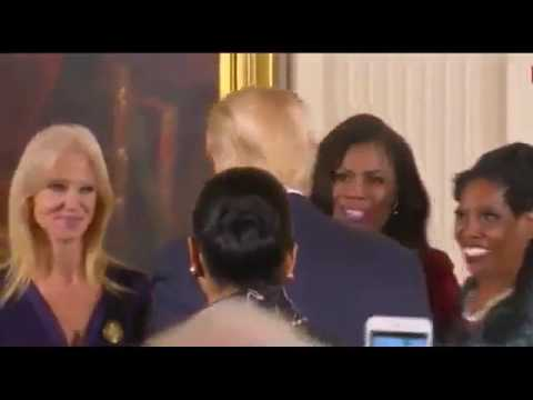 President Trump hugs Kellyanne Conway and Jared Kushner and Hope Hicks