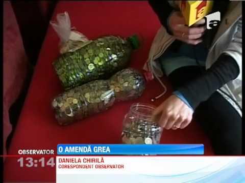 O femeie din Targu Mures si-a platit amenda de 1500 de lei in monede