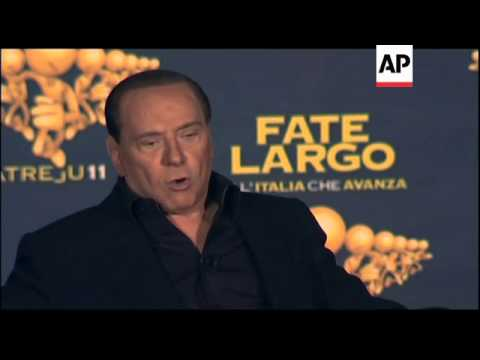 Berlusconi says he wanted to resign over betrayal of Gadhafi