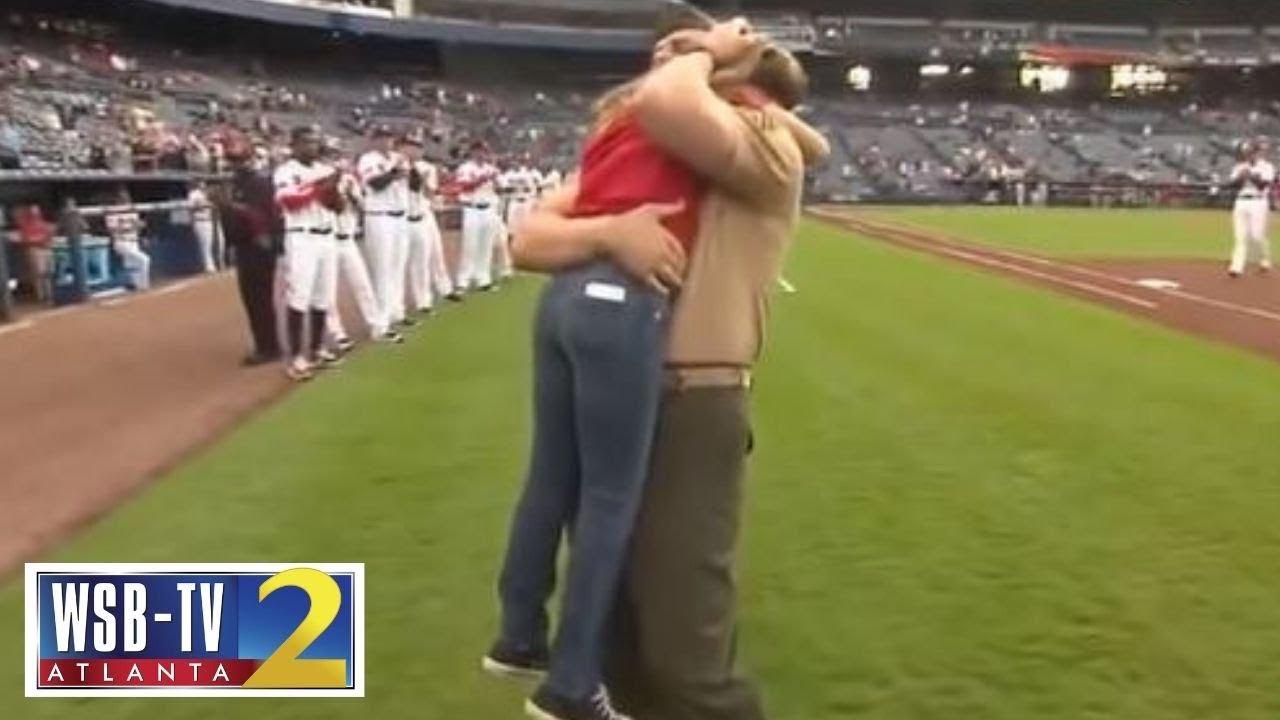 Military dad surprises his daughter at Atlanta Braves game #1