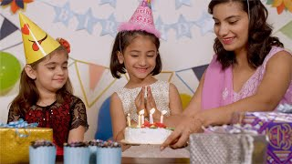 Birthday Celebration at Indian Family - Caring mother brings the cake with candles for her daughter