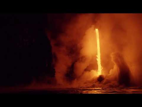 Glowing Lava Lights Up Steam From Kilauea