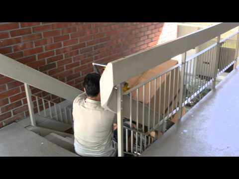 Moving a safe upstairs with a stair climber.