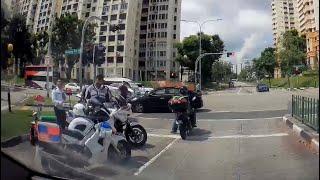5sec208 motorbike fbm7826x ignoring singapore traffic police officers, made a left turn via pavement