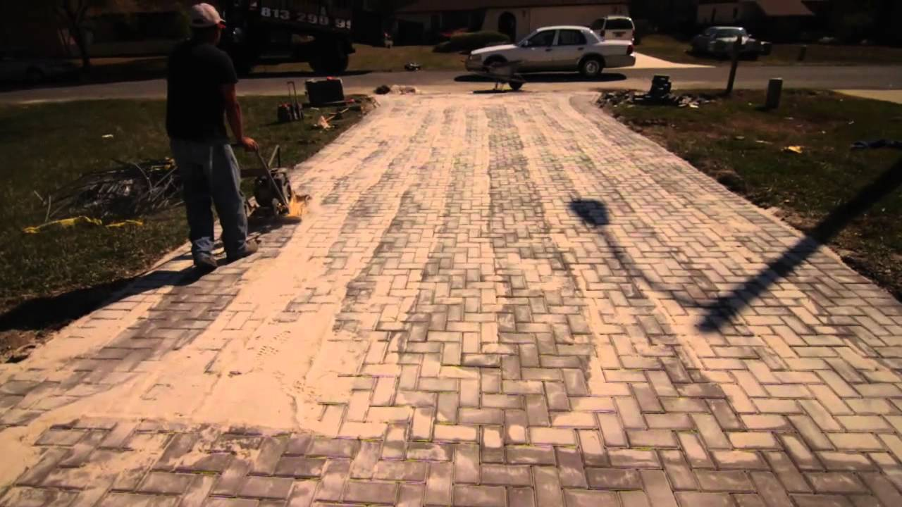 how to compact sand in the cracks of new brick pavers