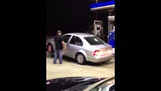 Car repo while putting gas