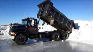 Trucks at the Snow Dump