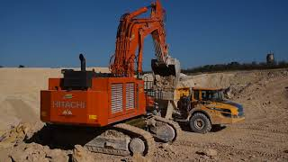 Hitachi EX1200 loading Volvo A30G