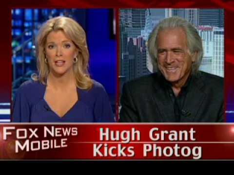 Hugh Grant Kicks Photog
