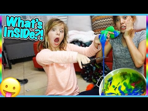 Thumbnail: 🙃CUTTING OPEN 60 SLIME STRESS BALLS! WHATS INSIDE? 🙃
