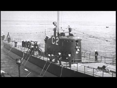 Sailors handling lines aboard a submarine at a dock in the United States. HD Stock Footage