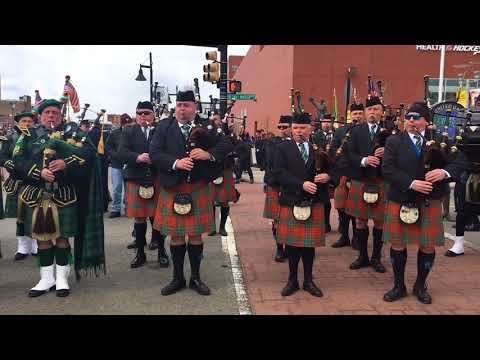 Pipe  bands play Amazing Grace prior to Newark Parade