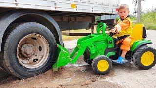 Um caminhão preso na lama - Dima monta um trator para ajudar