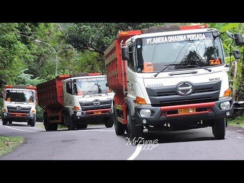 Dump Trucks Uphill Delivering CTB Aggregate