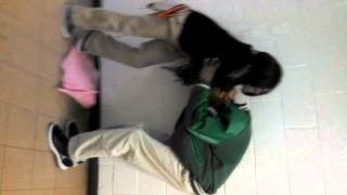 boy and girl fight in hallway