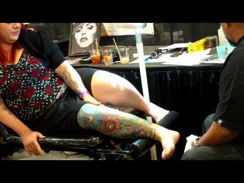 Pt 79 The Tattoo Fest In Boise Idaho. This Lady Is Getting One Done. Eye In Flower