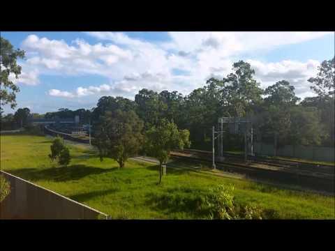 Queensland Rail trains operating through Carseldine station.