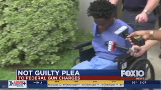 Man accused in police shootout pleads not guilty to federal charges