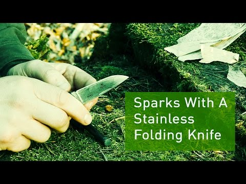 Sparks With A Stainless Steel Pocket Knife And Ferro Rod