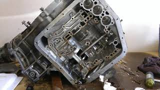 Part 4 (of 10) Transmission Teardown - Rebuild 1994 Toyota Camry Engine & Transmission 5SFE & A140E(Part 4 of 10 Complete engine and transmission overhaul of a 1994 Toyota Camry. This video shows teardown/disassembly of the transmission; a Toyota A140E ..., 2012-01-01T10:10:36.000Z)