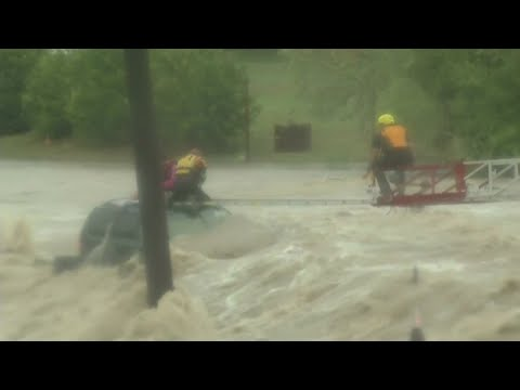 Crews rescue driver from high water in San Antonio