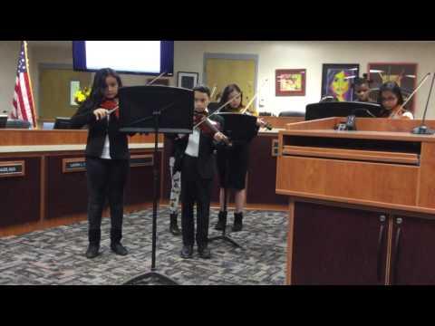 "Palomino Intermediate School honor orchestra playing ""Paradise School District"". ( Elias Contreras )"
