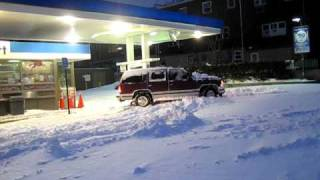 SUV FAIL stuck in snow at gas station