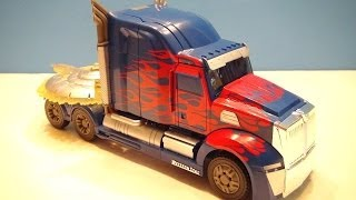 TRANSFORMERS 4 AGE OF EXTINCTION OPTIMUS PRIME FIRST EDITION VIDEO TOY REVIEW