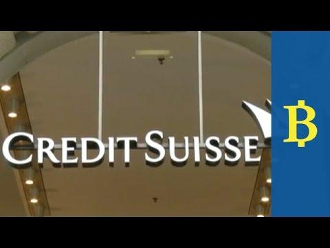 Credit Suisse write-offs hit profit, drag down shares