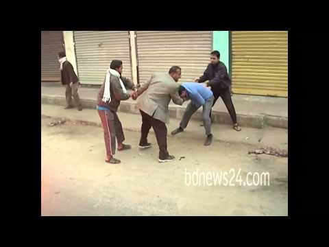 Bangladesh Police (DB) man is beaten during Jamaat strike in Barisal