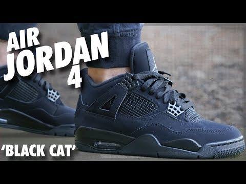 black and blue jordan 4s