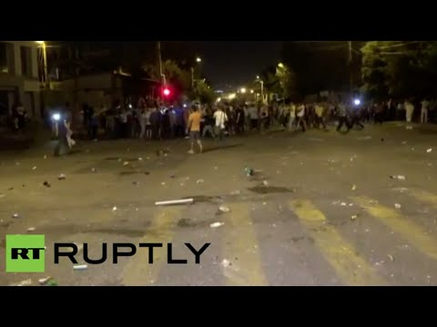 Tear gas, clashes outside police HQ in Armenian capital as h