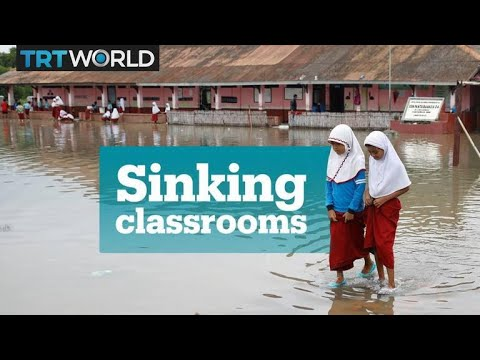 These Indonesian school children have to study in flooded classrooms
