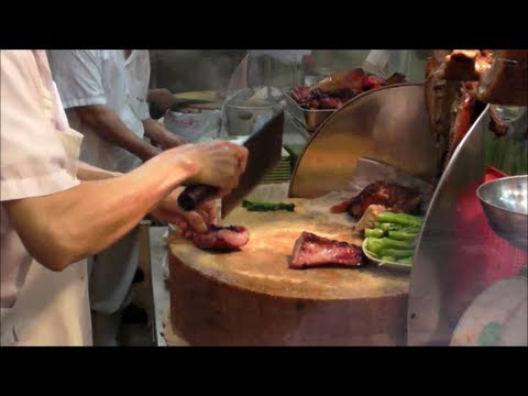 Action in the Kitchen of a Chinese Restaurant. Hong Kong Chinese Food.