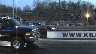 Badass Cummins dually diesel smoking down the drag strip