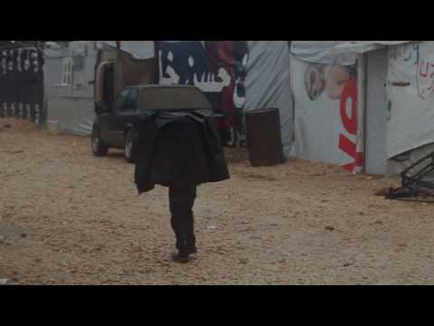 Syrian refugees endure cold, soaking rain in the Bekaa Valley