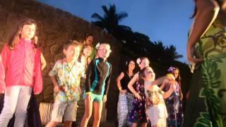 hula girl shakes booty at grand luau on maui