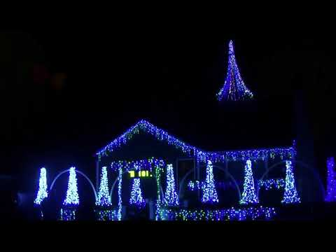 jim winder a friend of the homeowners transforms this neighborhood home into a music synched extravaganza of christmas lights