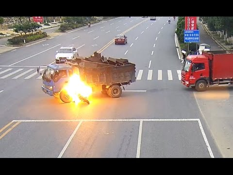 Truck Driver Rescues Motorcyclist after Fiery Crash in East China City