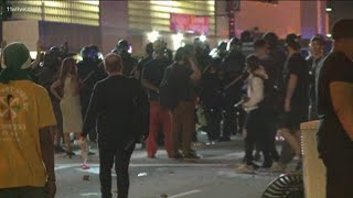 Atlanta officers respond with tear gas after protesters throw bottles, other objects them