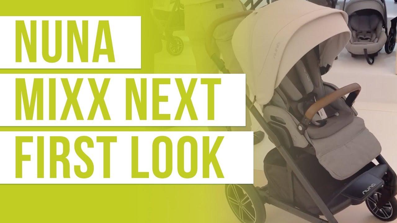 Beige Nuna MIXX Next stroller against showroom background with