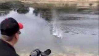 M-134A1 Vulcan Airsoft Minigun Firing Airsoft BBs into Pond