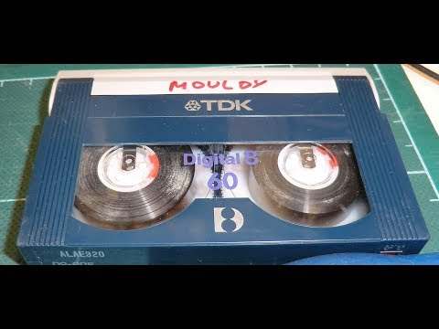 Repairing 8mm video tapes with mould and other damage.