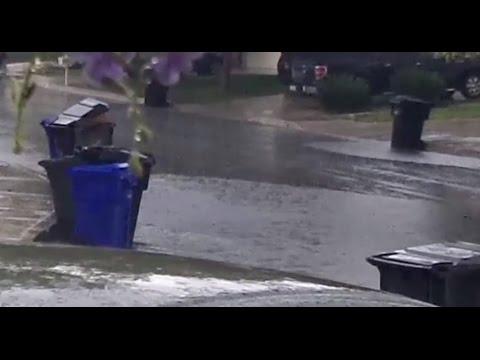 HEAVY RAIN POURS DOWN FLOODS STREET IN FONTANA CALIFORNIA. OCTOBER 5 2015.