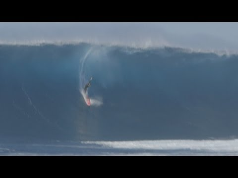 British surfer Tom Lowe rides one of the world's most dangerous waves
