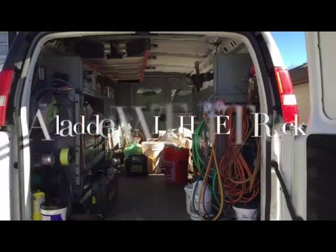 a ladder with jet rack in a contractor s van